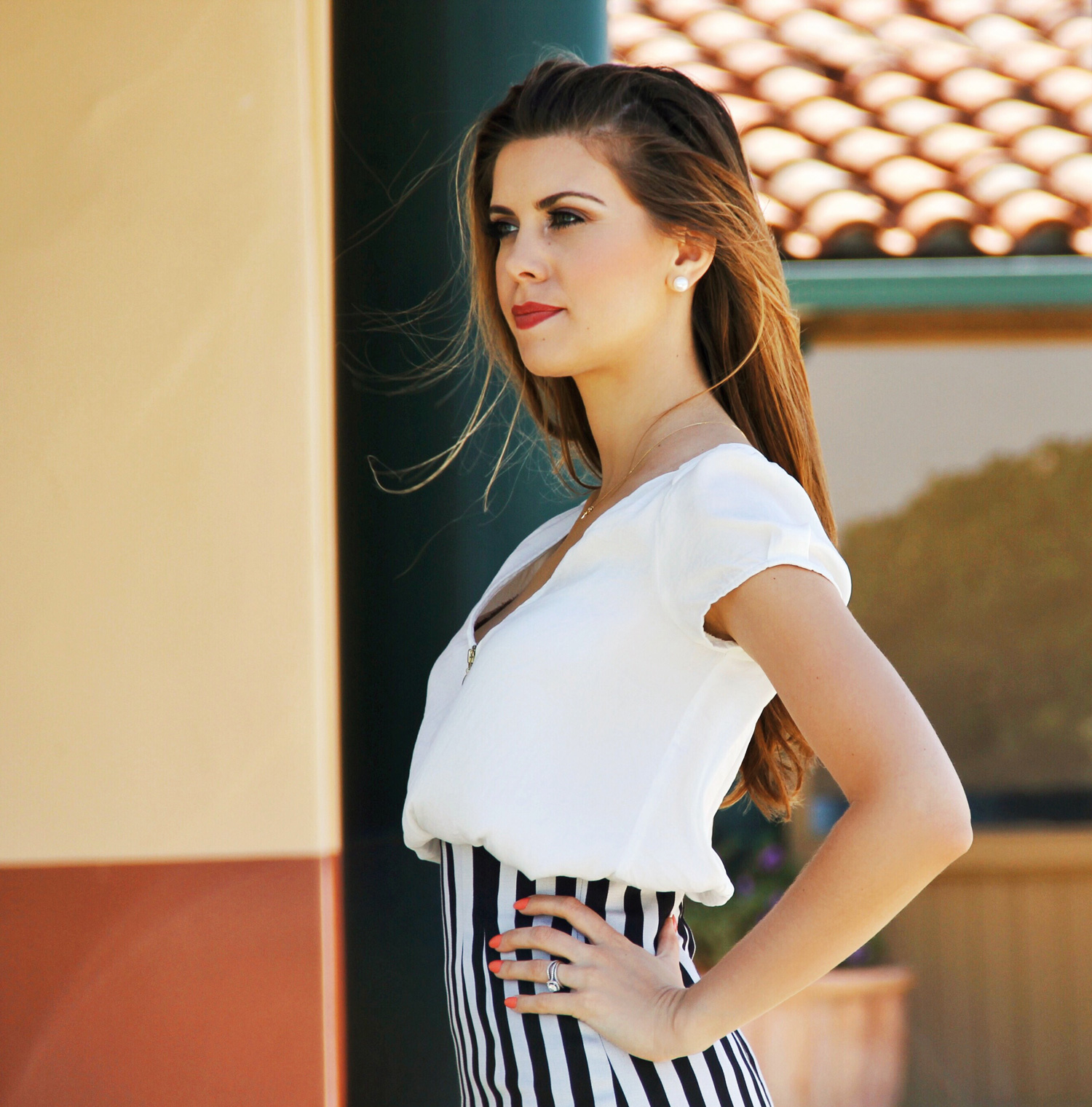 Classic outfit, elegant, striped skirt, soft white blouse, pearl bracelet, gold charm.