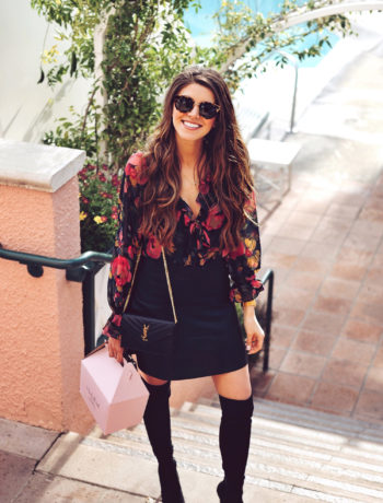 Fashion and lifestyle blogger Adelina Perrin of The Charming Olive wearing Majorelle Top from Revolve, Vince skirt from Hautelook, and Joie boots from Nordstrom