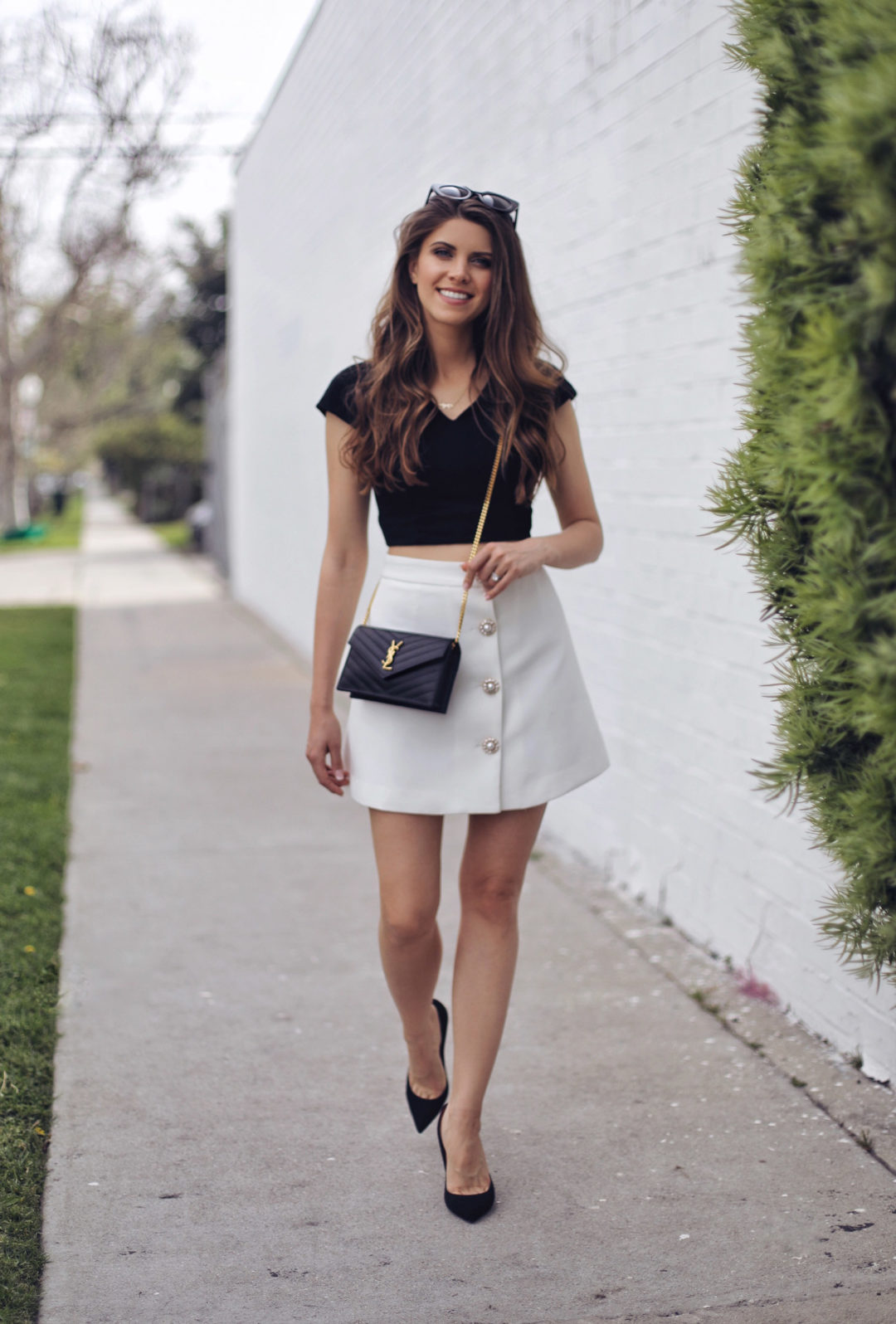 Fashion and lifestyle blogger Adelina Perrin of The Charming Olive wearing Chicwish Top, Chicwish skirt, Saint Laurent bag, Cesare Pacciotti shoes