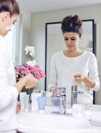Fashion and lifestyle blogger Adelina Perrin of The Charming Olive using Sisley-Paris as a daily beauty routine