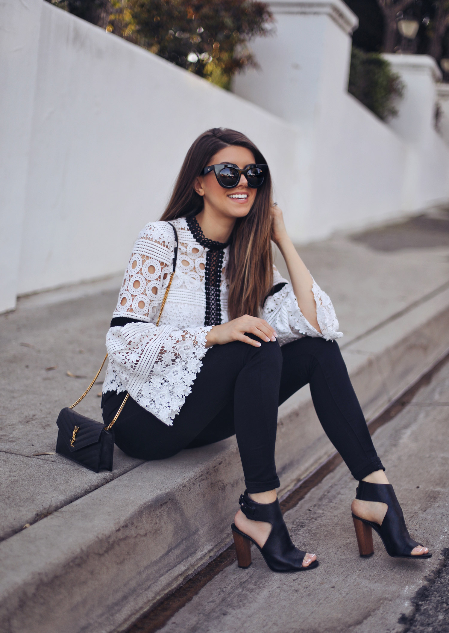 Fashion and lifestyle blogger Adelina Perrin of The Charming Olive wearing Chicwish Top, Mott & Bow Jeans, Vince Shoes and Saint Laurent Black Crossbody