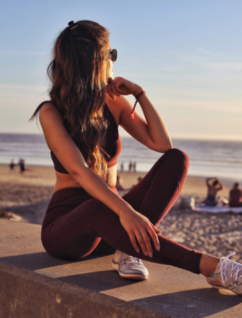 Fashion and lifestyle blogger Adelina Perrin of The Charming Olive wearing Grana active wear and nike sneakers
