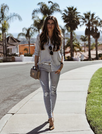 Fashion and lifestyle blogger Adelina Perrin of The Charming Olive wearing L'Academie shirt from Revolve Clothing, Parker Smith Jeans and Blue Stripes
