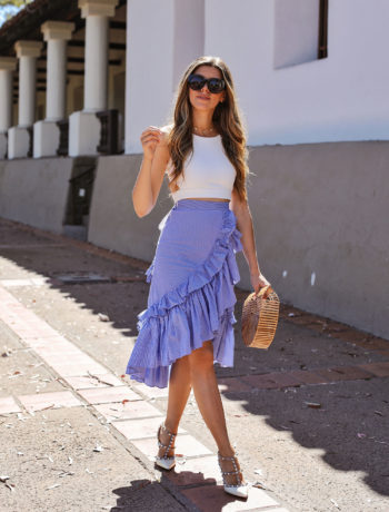 Fashion and lifestyle blogger Adelina Perrin of The Charming Olive wearing Chichwish Top and Skirt and VICI Collection bag