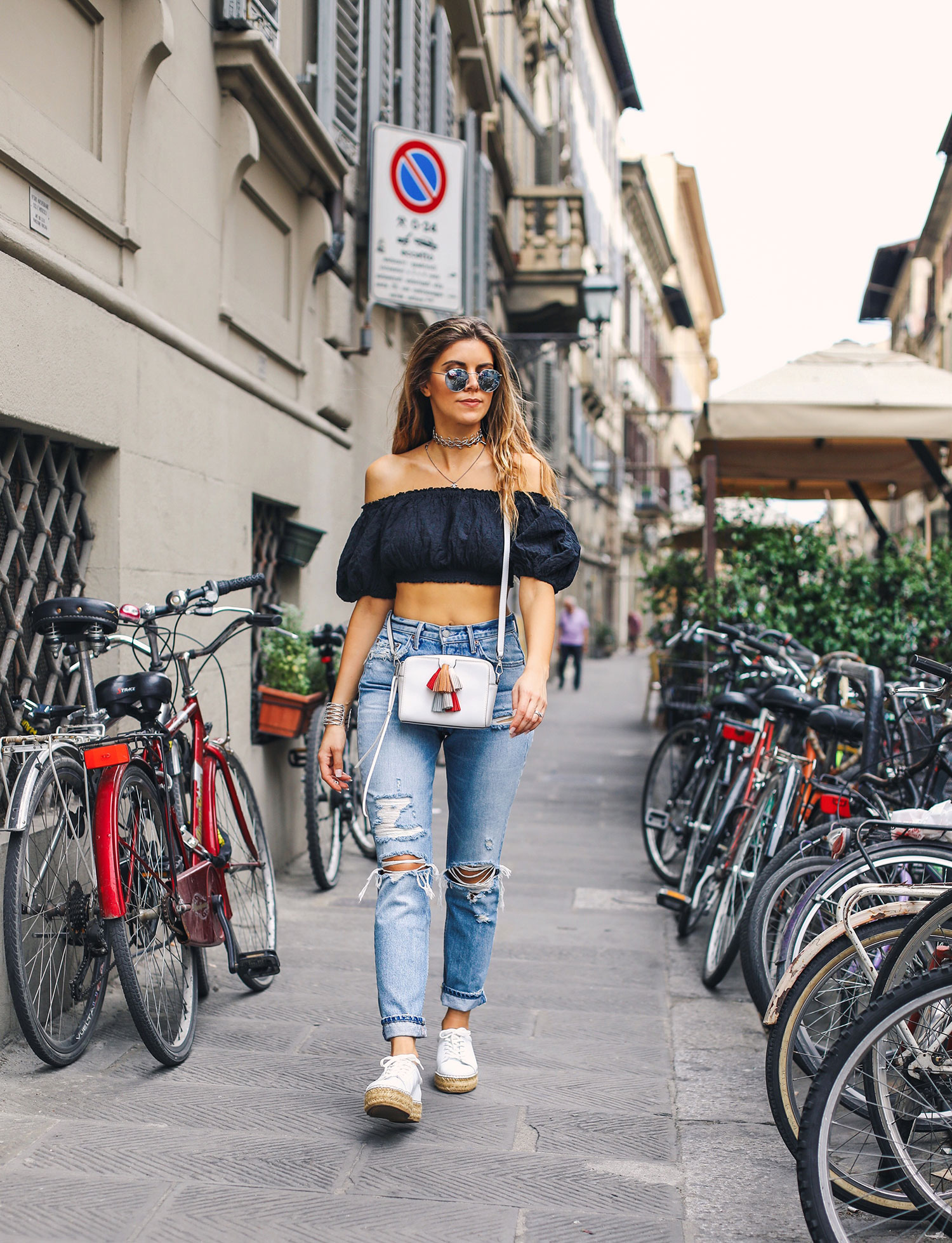 Fashion and lifestyle blogger Adelina Perrin of The Charming Olive wearing Urban Outfitters top, Grlfrnd denim and Rebecca Minkoff bag