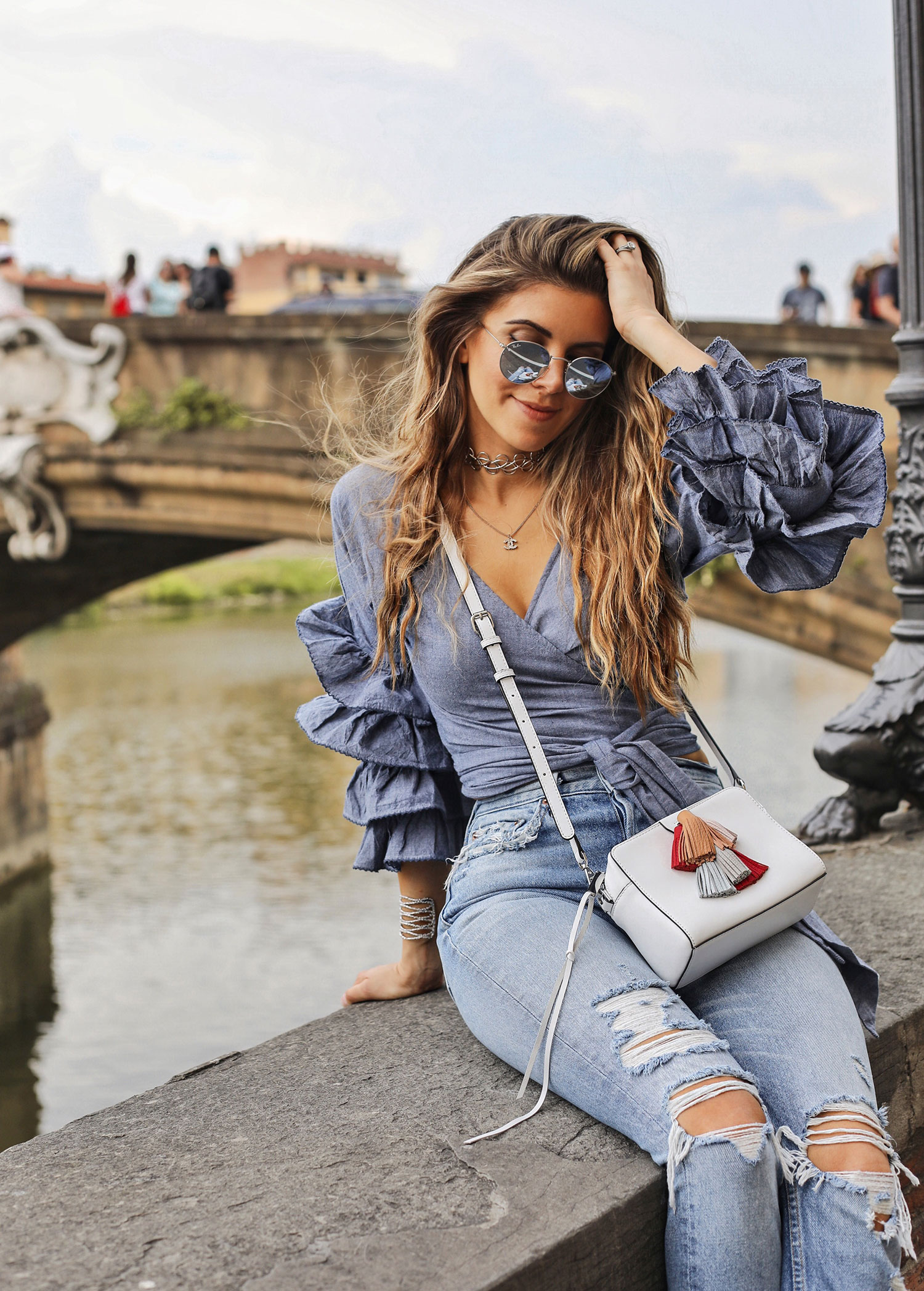 Fashion and lifestyle blogger Adelina Perrin of The Charming Olive wearing Tularosa wrap top, Grlfrnd denim jeans and Rebecca Minkoff bag