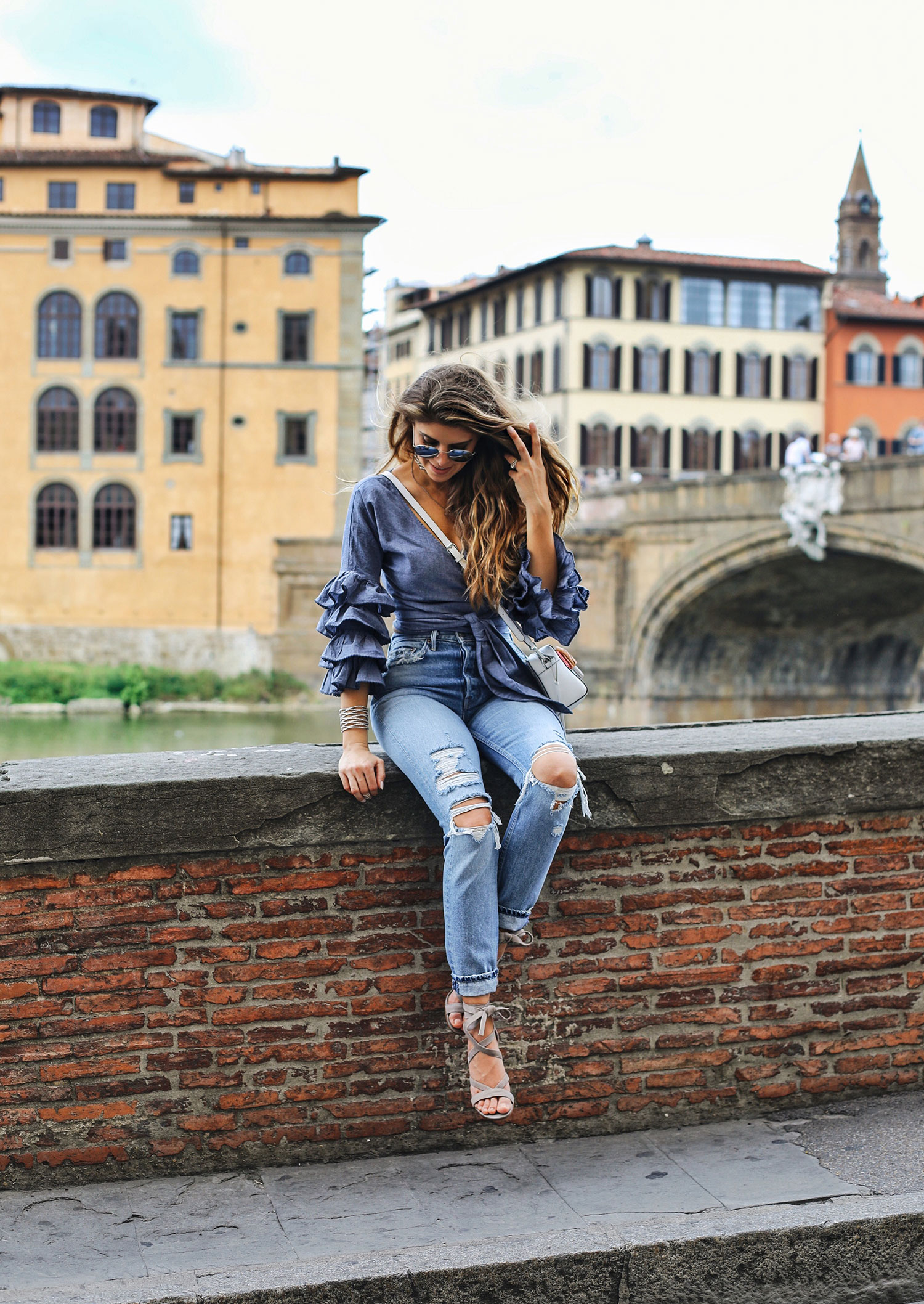 Fashion and lifestyle blogger Adelina Perrin of The Charming Olive wearing Tularosa wrap top and Grlfrnd denim jeans